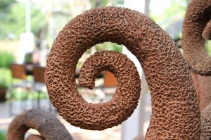 Brown concrete spiral shape like baked clay.